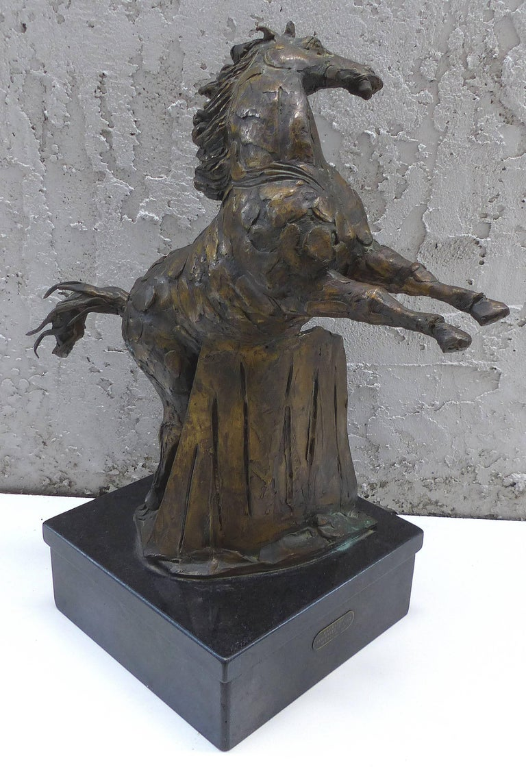 Offered for sale is a bronze sculpture of a rearing horse by the Mexican artist Heriberto Jaurez. Heriberto Juárez (March 16, 1932-August 26, 2008) was a self-taught Mexican sculptor, known for his depictions of women and animals. The bronze is
