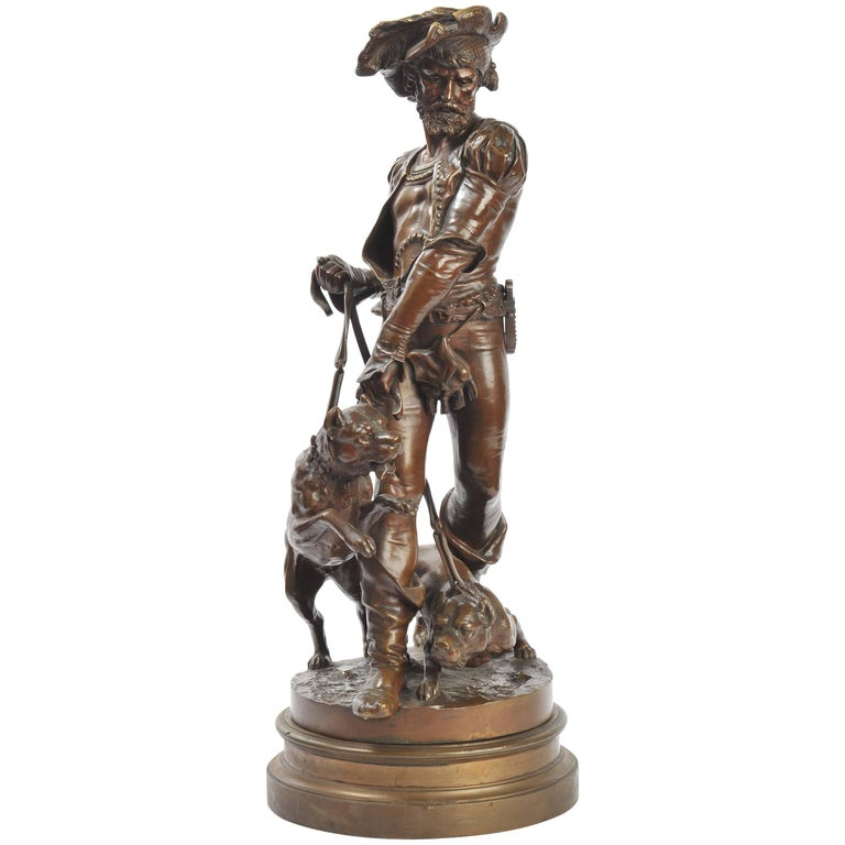 A very dramatic bronze statue, depicting a 19th century Houndsman with his two hounds. Revolves on a bronze socal base.