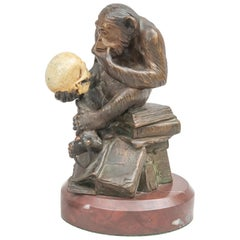 Bronze Monkey Holding a Human Skull and a Caliper