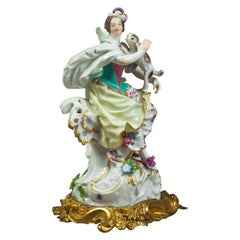 Bronze Mounted German Porcelain Figure of a Lady with Dog, Meissen, circa 1750