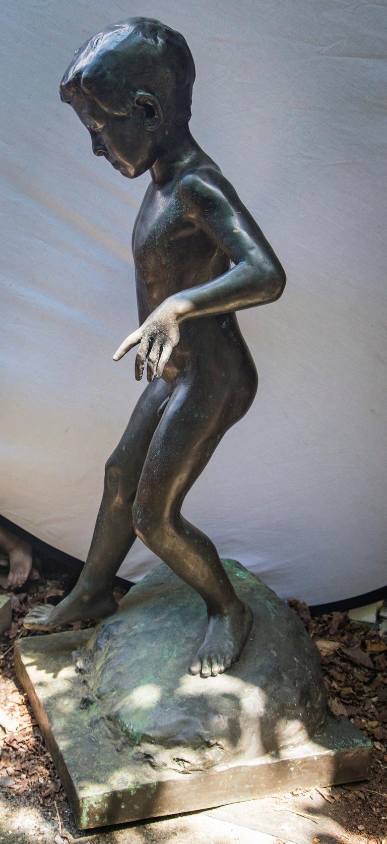 Hand-Crafted Bronze of a Nude Boy For Sale