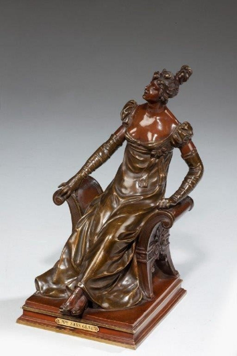 A bronze of a Mme Sans-Gene (Madam Without-a-Care) by Noel-Rouffier, depicted as an Edwardian lady on a window seat.