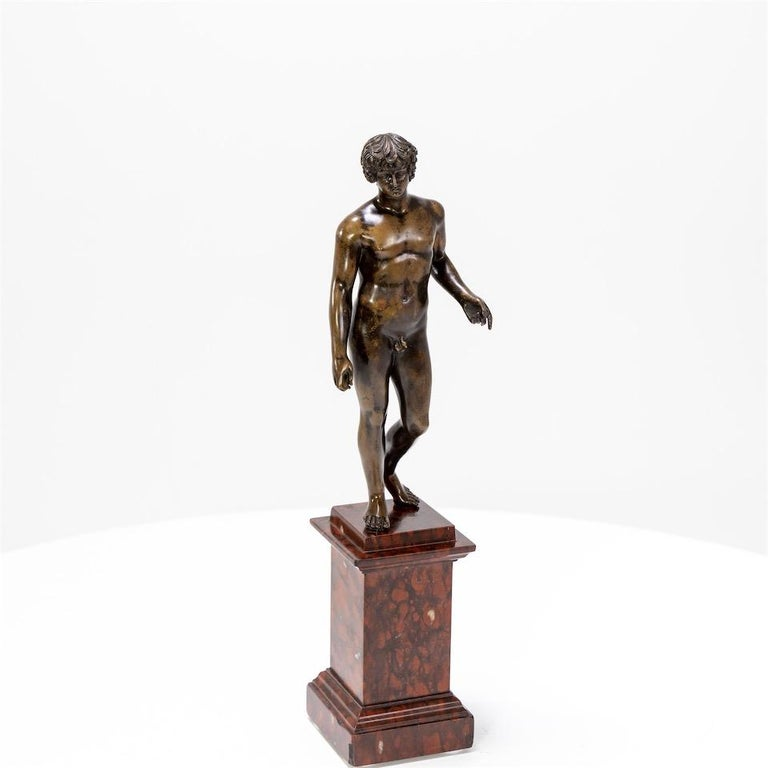 Bronze of Antinous Farnese standing on a red marbe griotte pedestal with beautiful, burnished patina.