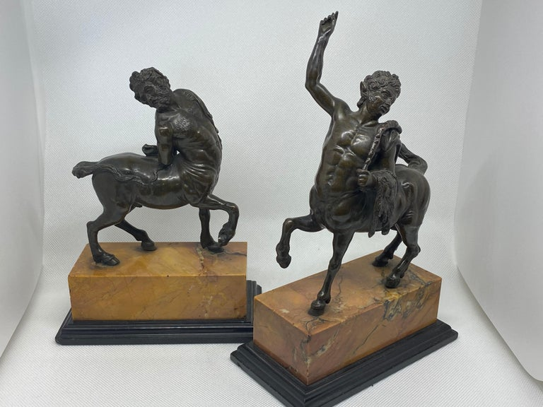 Very finely cast bronze copies of the Furietti Centaurs, one depicting a young centaur and the other depicting and old centaur. They are each mounted on a marble base and are unsigned. These bronzes are 19th century copies of the two Roman (or