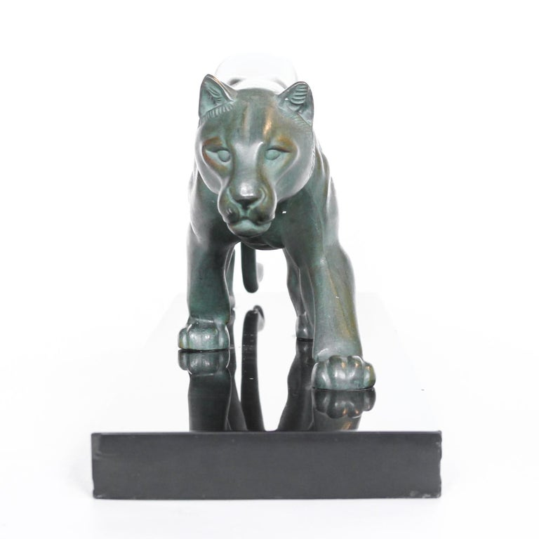 An Art Deco, patinated spelter study of a prowling panther, mounted on a black marble base. Signed 'M. Leduc' to hind leg. Minor chips to base.