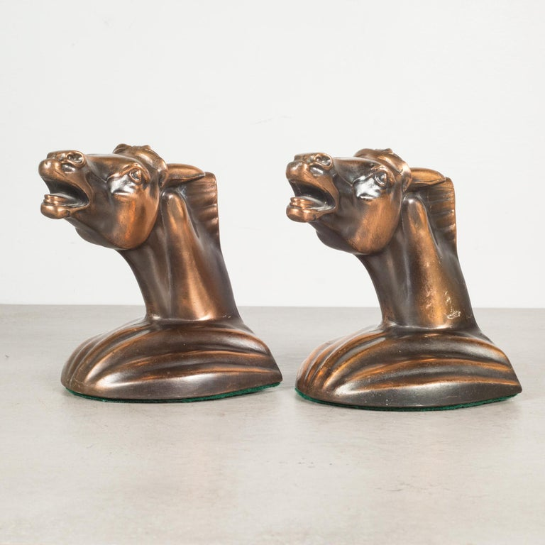 About  This is an original pair of Art Deco style cast metal Trojan horse bookends manufactured in the USA. Both pieces have retained their original bronze finish and are in good condition with appropriate patina for their age.