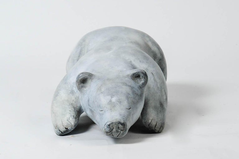 Solid bronze polar bear with white patina  Signed but unreadeble.