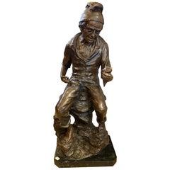 Bronze Sculpture of a Fisherman