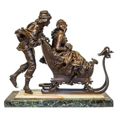 Bronze Sculpture of a Man Pushing the Woman's Sled by Charles Ferville-Suan