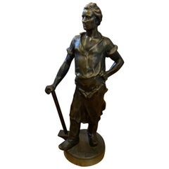 Bronze Sculpture of a Working Man holding a Sledgehammer