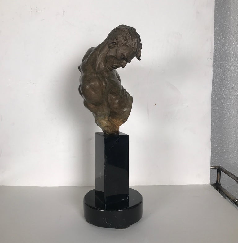 Extraordinary bronze of a gymnast by premier sculptor Richard MacDonald. The bronze with an unusual patination process know to define the sculptor attached to a polished black marble base. 14 inches tall. This piece is signed and dated by the