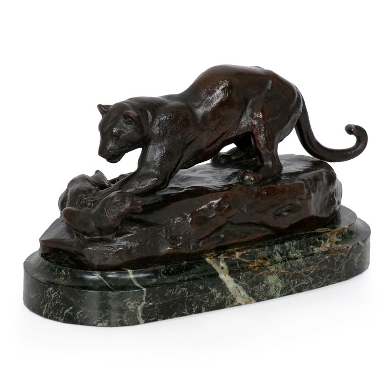 A rare and exquisite cast that has not been on the market since it was acquired by a private collector in 1935, this exquisite model of Panthère suprenant un zibeth (Panther attacking a civet cat) depicts the large beast pawing at the snarling cat