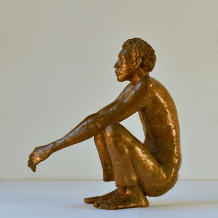 Waiting man, bronze cast sculpture of a seated man by Dutch Artist Lies Gronheid, Amsterdam, 1986. It is of a man seated in the action of anticipation whether staying or delaying movement in time and space. There are many unanswered questions to