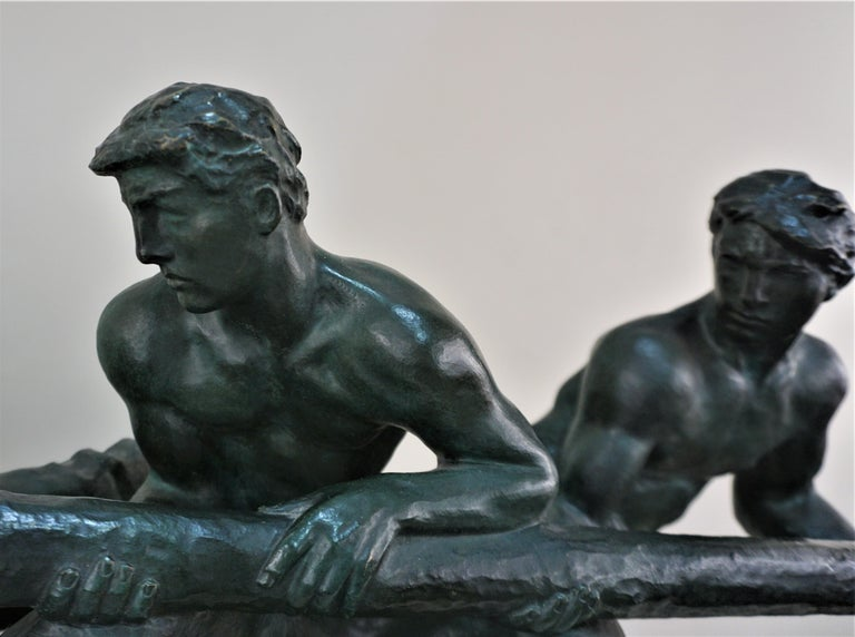 A bronze sculpture two men steering signed by Hungarian - French sculptor Alexandre Kelety.