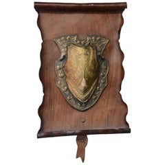 Bronze Shield on Rustic Leather Scroll Wall Hanging