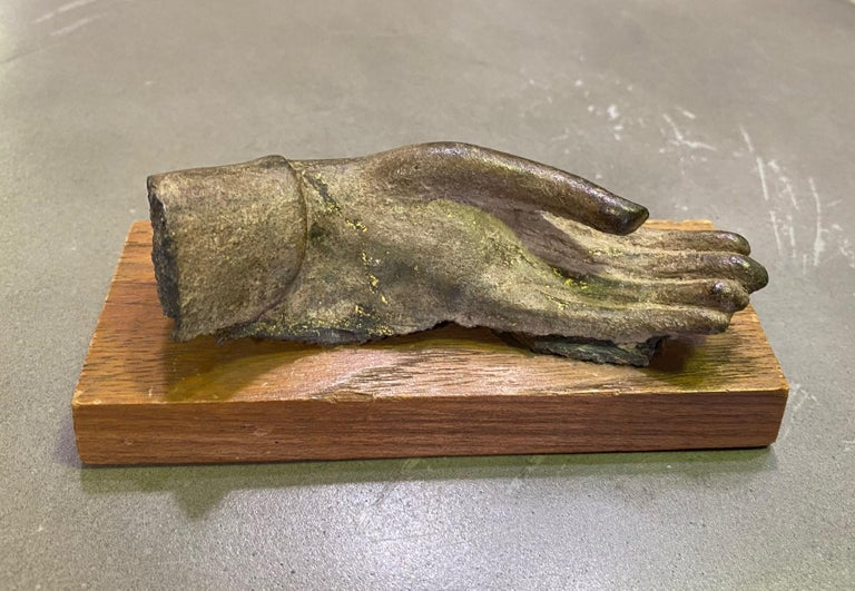 A wonderful and very special piece.  This bronze buddha hand sculpture, perhaps a fragment of a larger piece at one time, originally came from the prestigious Doris Wiener Gallery in New York City (please see the gallery tag on the underside of