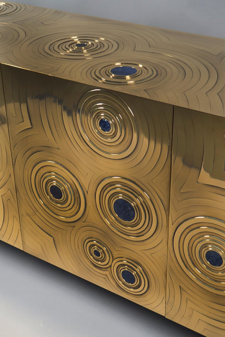 Polished bronze sideboard featuring concentric circles throughout with a Lapis Lazuli inset in each center. Boulloud's pieces are very limited editions or unique creations.