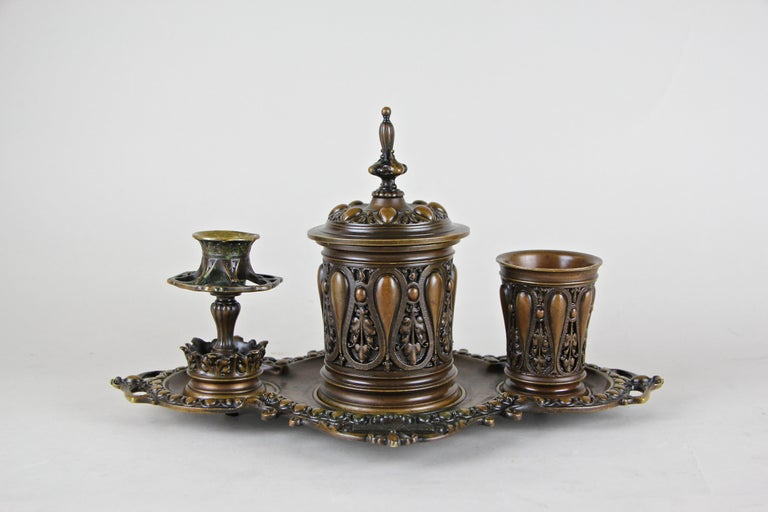 Fabulous bronze smoking set from the German Historism period circa 1880. This artful made heavy full-bronze set consist of four pieces: a nice shaped tableau on which stands a big tobacco box with a folding lid in the center (and removable brass