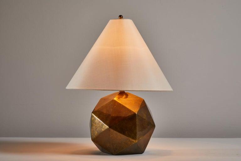 Bronze table lamp. Manufactured in the USA, circa 1980s. Original cord. Custom silk shade. Takes one E27 Edison 75 watt maximum bulb. Bulbs provided as a one time courtesy.