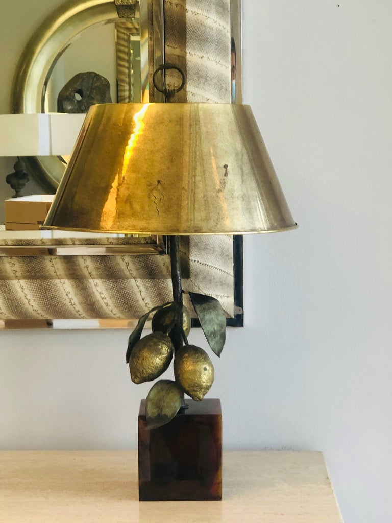 A bronze table lamp with lifesize lemons. Faux tortoise acrylic base. Measurements include shade and finial.
