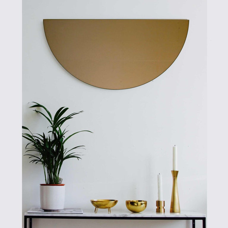Delightful crafted bronze tinted mirror frameless with a floating effect. Designed and handcrafted in London, UK.  Alguacil & Perkoff new and unusual Luna Orbis mirror collection provides the freedom to achieve multiple configurations with one