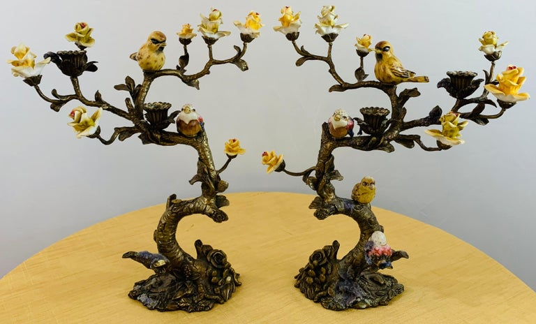 A beautiful pair of candleholders / candelabras crafted in Bronze in a shape of a tree with colorful ceramic flowers and birds. Each candelabra can hold two candles. This pair will add style to your dining experience and create an amazing ambiance