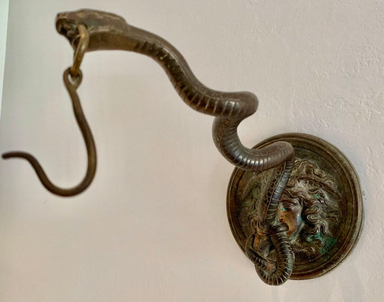 Bronze Wall Mounted Hook of Medusa and Serpent in the Roman Style In Good Condition For Sale In East Hampton, NY