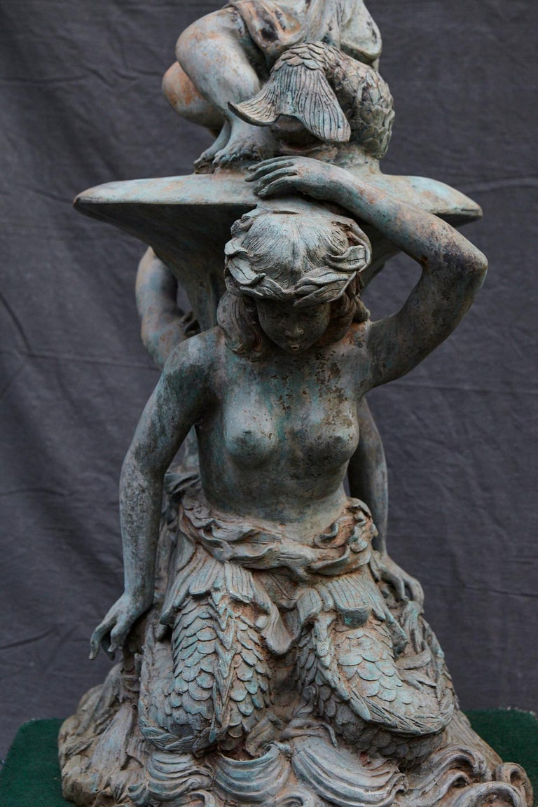 Bronze Water Garden Statue of Merman and Mermaid Carrying a Merboy For Sale 5