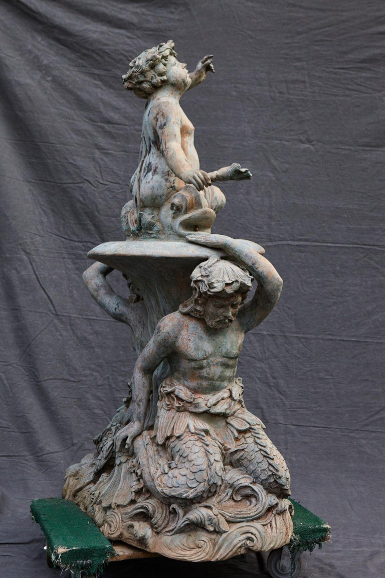 American Bronze Water Garden Statue of Merman and Mermaid Carrying a Merboy For Sale