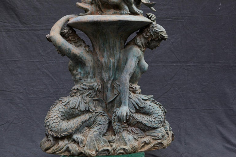 Bronze Water Garden Statue of Merman and Mermaid Carrying a Merboy For Sale 1