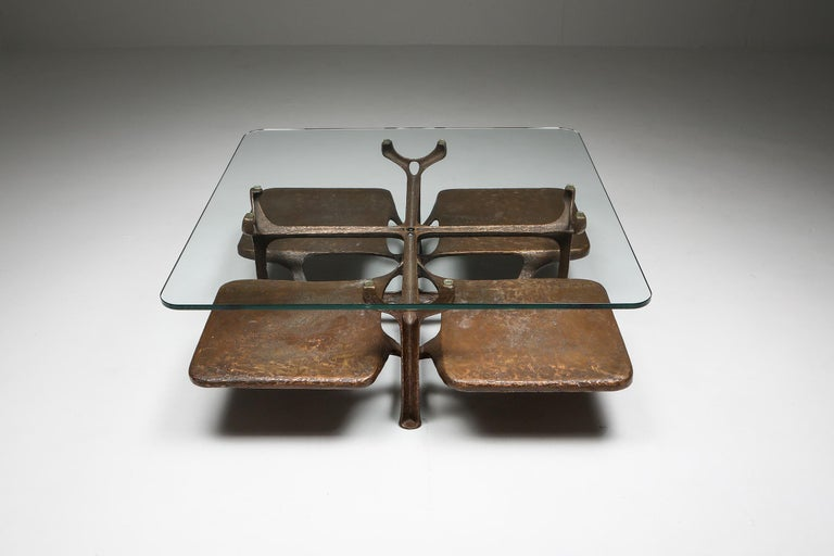 Bronze sculptural coffee table, monogrammed AH  Artist two-tier coffee table in bronze with glass top Brutalism meets Hollywood Regency Superb piece in cast bronze comprised of four leafs with a clear round edged glass top. Sculpturally strong