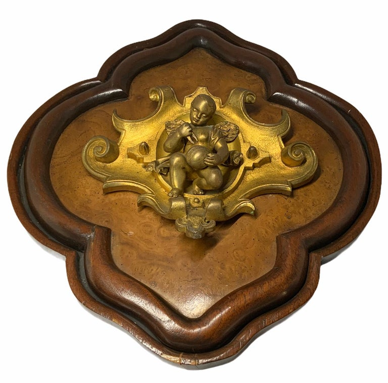 Hammered Bronze Wood Plaque of a Winged Cherub For Sale