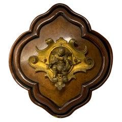 Bronze Wood Plaque of a Winged Cherub