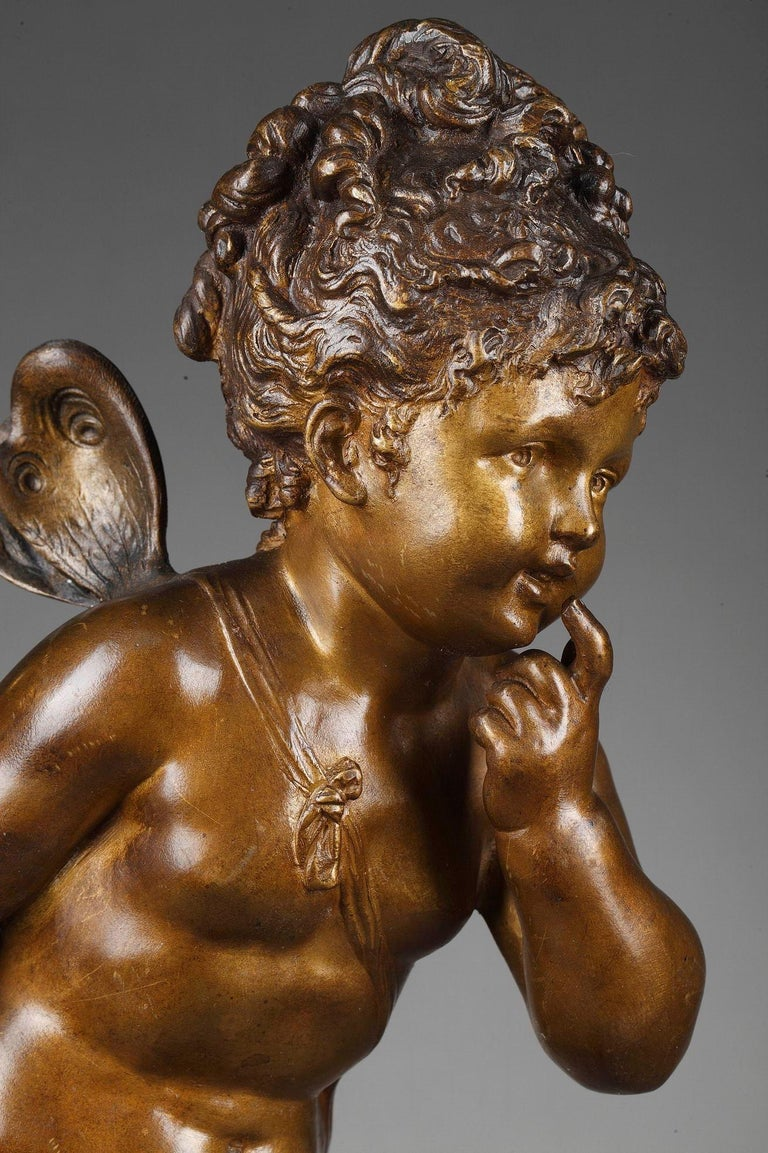 This brown and gold patinated bronze figure was crafted by the French sculptor Paul DUBOY. It features a little girl, Psyche, standing on a naturalistic base. The bronze sculpture is set upon a round marble plinth. Signed: Paul Duboy. Paul Duboy