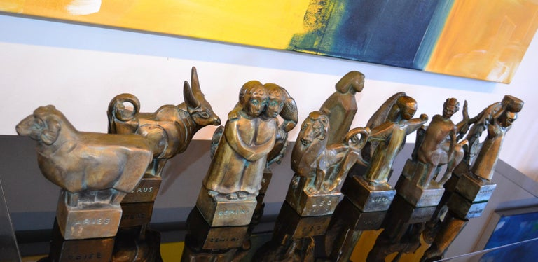 Very rare set of 12 Astrological sign cast bronze brutalist sculptures by Fred Press. Each zodiac sign represented, beautiful age and patina.   Early in the 1950s, Mr. Press moved to New York City and for the next three decades, as chief designer