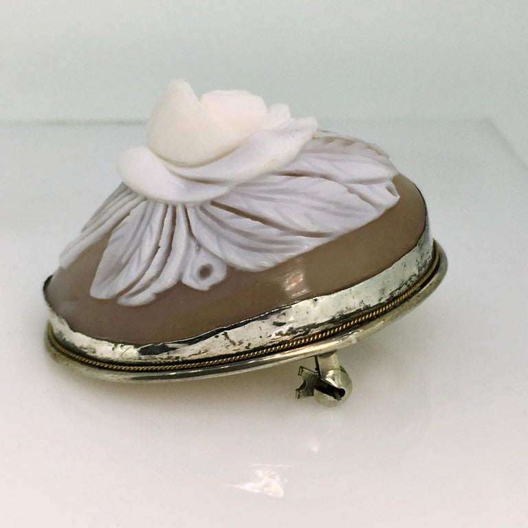 Brooch, Antique, Silver, Shell Cameo, 1900 An exquisite antique hand carved round three dimensional shell flower cameo brooch with twisted wire decoration on the border, exceptional quality!  The cameo is gorgeous of a big flowers with leaves on the