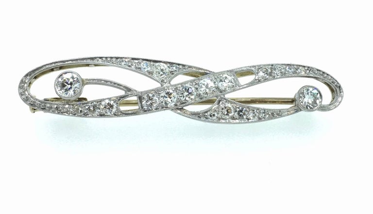 Art Deco barette brooch set in white and yellow gold, handmade in the Netherlands. Set with Old European and Single Cut diamonds. The Brooche is in complete original condition and comes with it's original case from a well known Jeweler goldsmith in