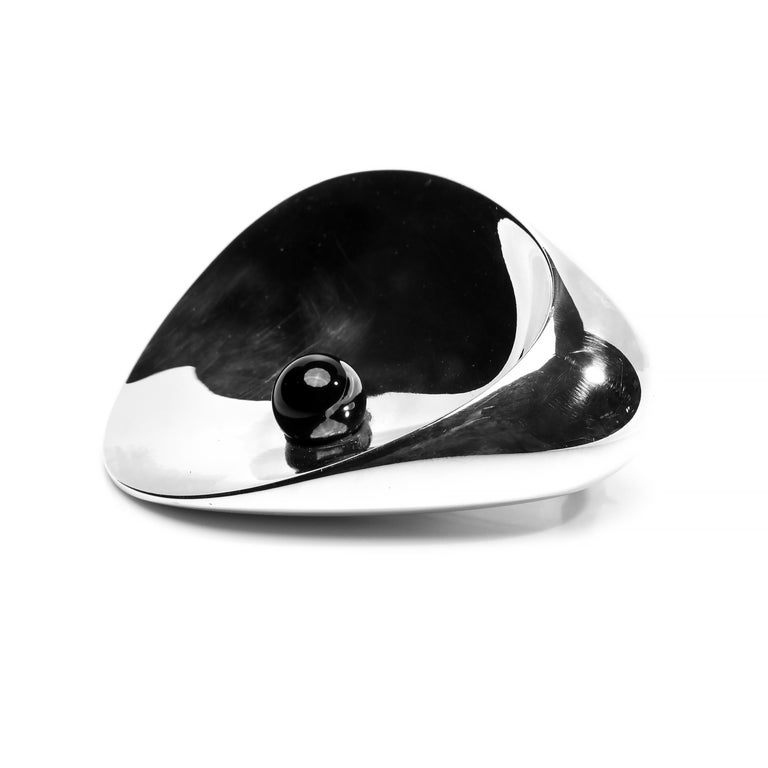 """This magnificent and brilliantly simple silver and onyx brooch was created in the 1950s for the firm for Georg Jensen by Nanna and Jørgen Ditzel. The wife and husband design team created spectacular pieces of furniture including the iconic """"Hanging"""