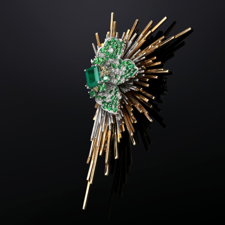 Antique-inspired Emerald, Diamond Gold Brooch with Yellow Sapphire  Shaped like a gorgeous feather with a flat-cut emerald as focus-point, this Emerald, Diamond Gold Brooch with Yellow Sapphire is so exquisite that it can be compared with one of the