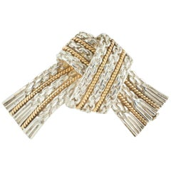 BROOCH Silver and 18 Karat Gold Bow Brooch Signed Hermès Paris, circa 1960