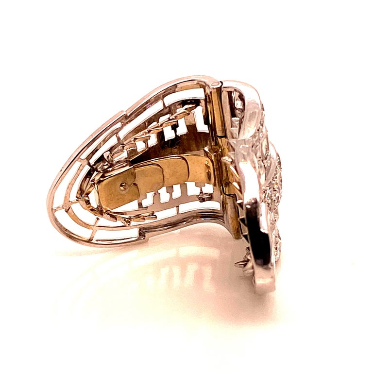 Brooche Art Deco a System ,5 Carats of extra white Diamonds Color E/F . the System is mounted on yellow Gold springs and the rest of the structure is Platinum. there are 3 teeth missing in the jaw can be for the passage of a cord or scarf. the