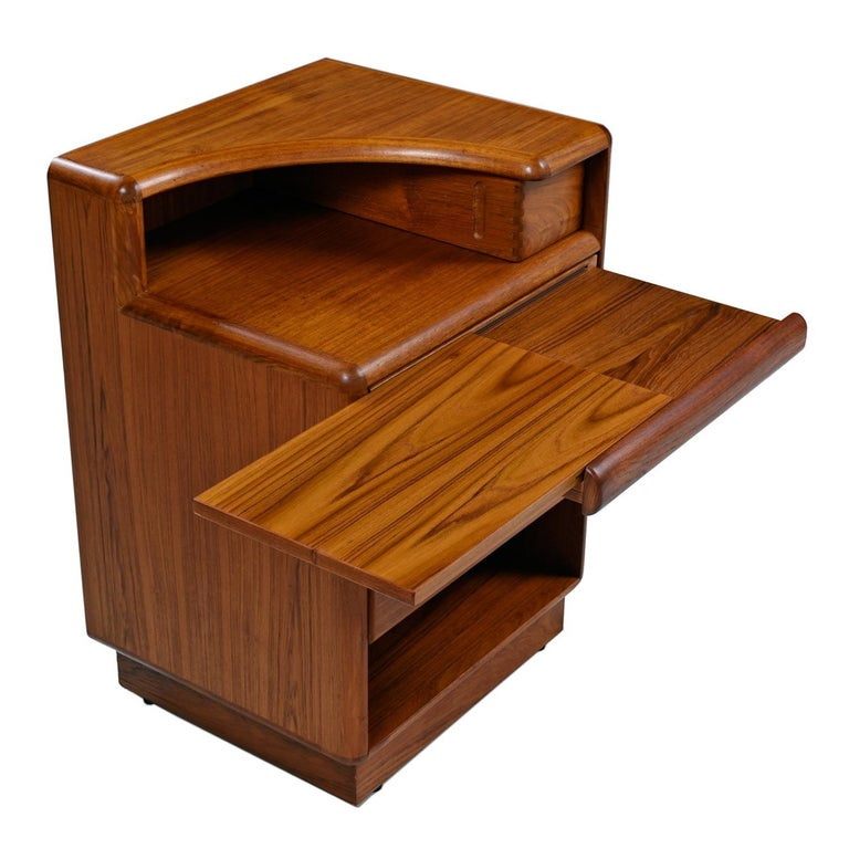 Sold as a pair  These may be the finest Mid-Century Modern Danish teak nightstands that we come to know. Made by Brouer, the nightstands hold many surprises. The mirrored nightstands (left and right side facing) were designed to perfectly flank a