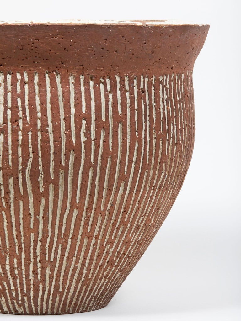 Modernist brown and white sgraffito ceramic planter by Grace Weber, featuring textural vertical stripes across the surface. Signed