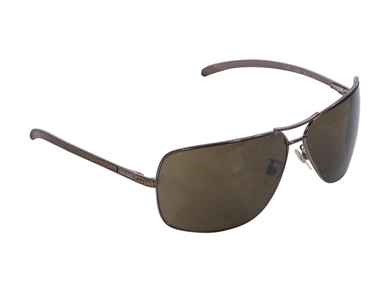 Product details:  Brown aviator sunglasses by Chanel.  Cushioned nose pads.  Snakeskin-trimmed stems.  2