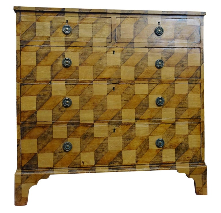 19th century faux painted by English craftsman on original 19th century mahogany five-drawer bureau. Three dimensional decorative motif in shades of brown. ARRIVAL TBD