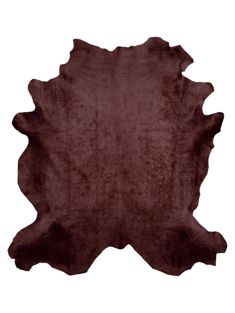 Brown Cowhide rug.  All of our Cowhide rugs are full hides and measure approximately 7' W x 8' L. They are of the highest quality from the French region of Normandy and naturally raised in a free roaming field. The hair of these cows is very