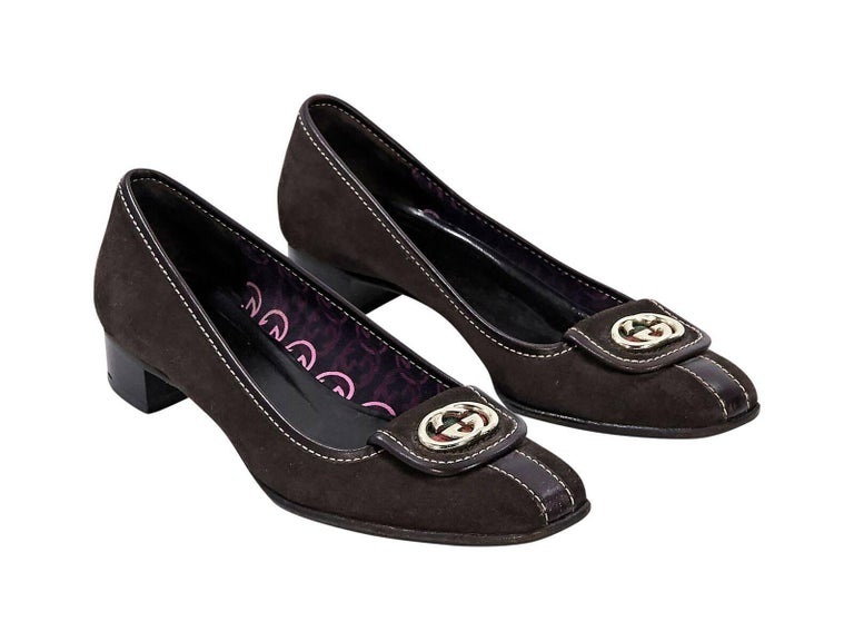 7c3607df015 Product details  Brown suede loafers by Gucci. Trimmed with leather. Logo  detail accents