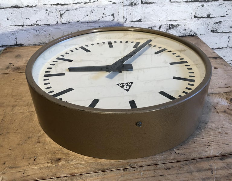 Lacquered Brown Industrial Wall Clock from Pragotron, 1960s