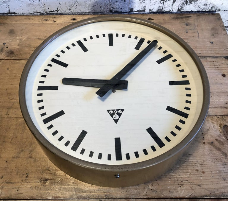 Glass Brown Industrial Wall Clock from Pragotron, 1960s