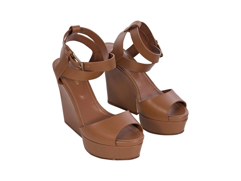 Product details: Brown leather platform sandals by Sergio Rossi. Open-toe. Ankle-buckle strap closure. Block heel. Gold-tone hardware. Style with a ruffled off-the-shoulder dress. 5
